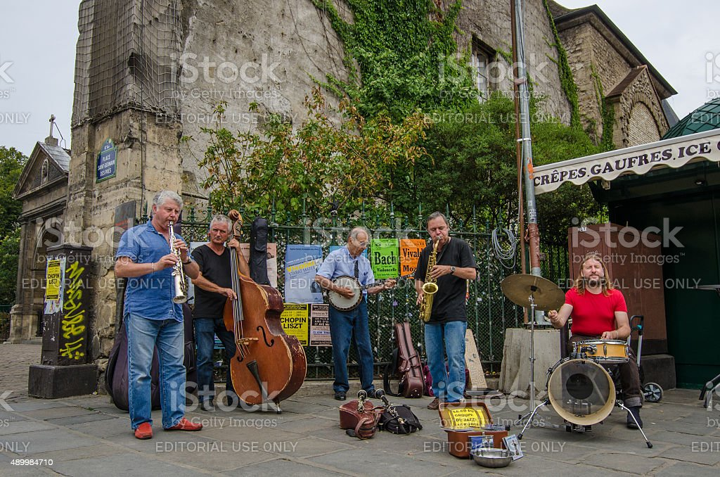 Street musicians entertain passers-by in Saint-Germain district stock photo