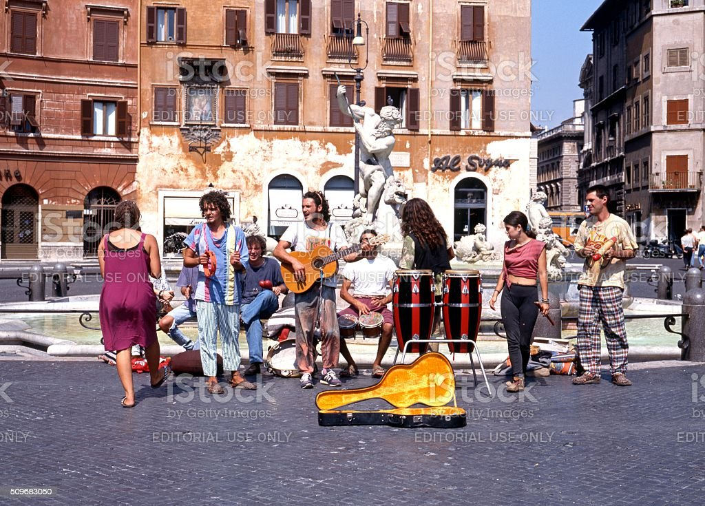 Street musicians in the Piazza Navona, Rome. stock photo