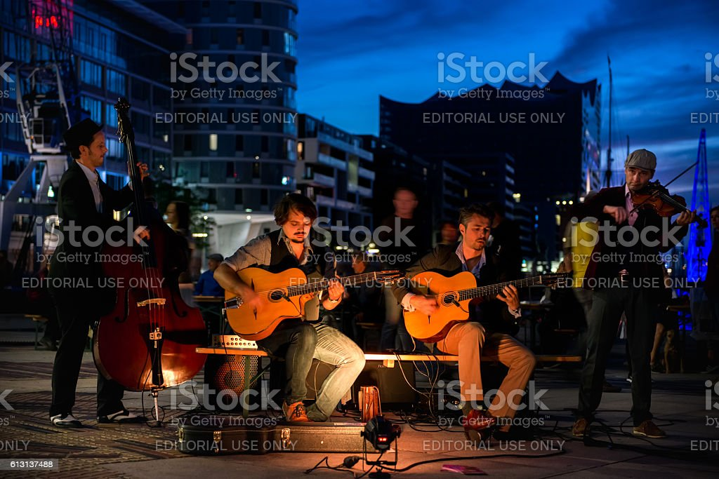 Street musicians in the port in Hamburg, Germany stock photo