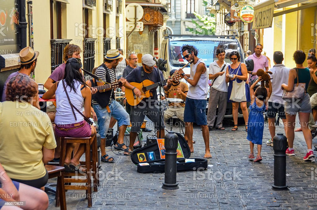 Street musicians performing on side alley in Granada, Spain stock photo