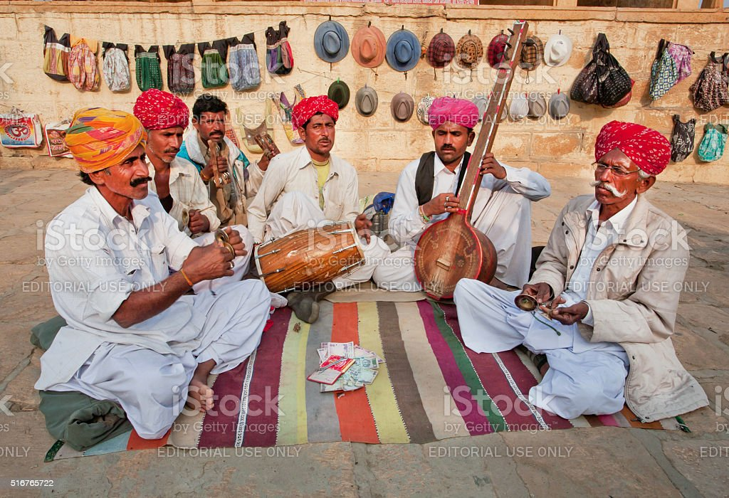 Street musicians play music on different traditional instruments stock photo