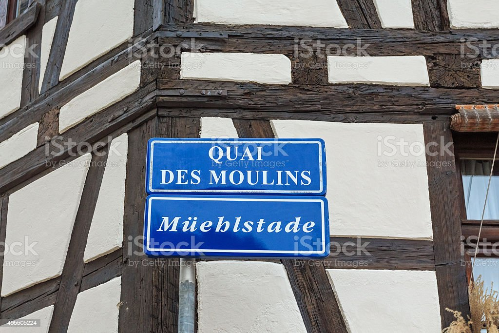 Street name sign on half-timbered house in La-Petite-France, Strasbourg Alsace stock photo