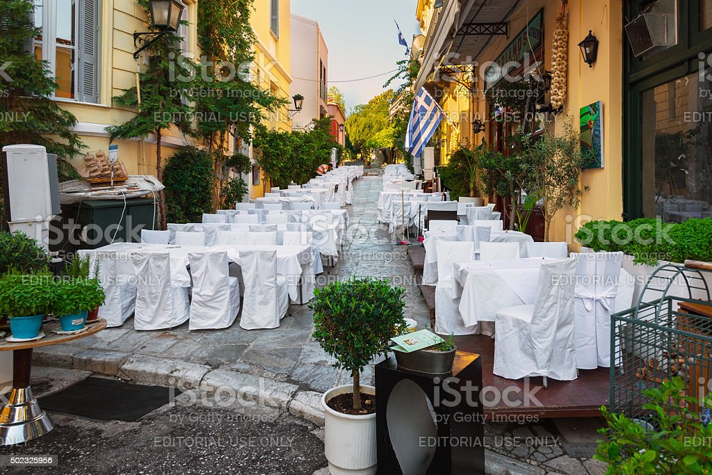 Street of Athens old town with decorated white tables stock photo