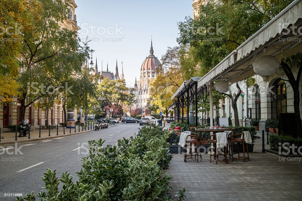 Street of Budapest with view at the Hungarian Parliament stock photo