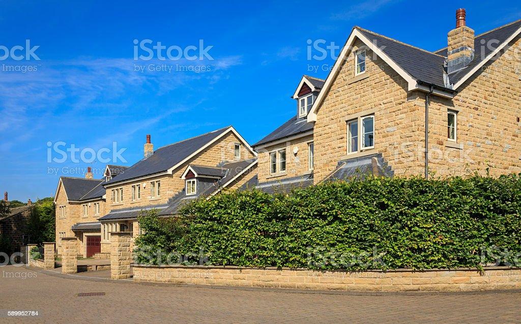 Street of modern suburban family houses stock photo