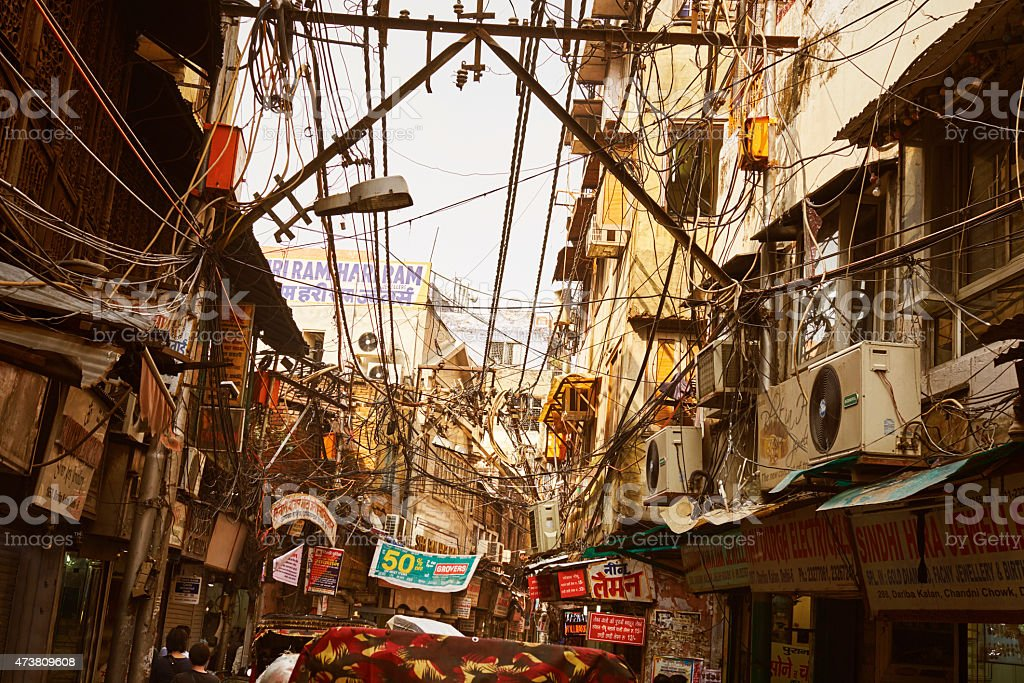 Street Of New Delhi With Messy Electric Cables And Advertising stock photo