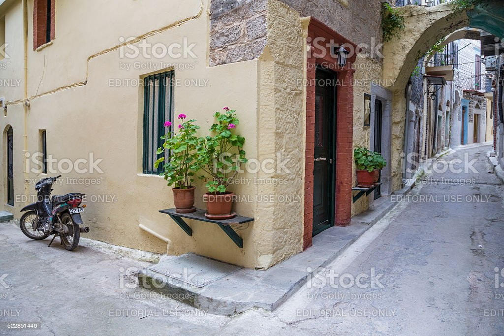 Street of Pyrgi town in Chios Island in Greece. stock photo