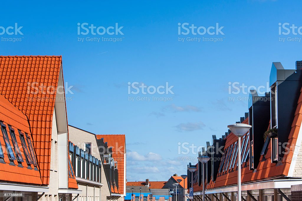 Street of red tiled roofs with skylights stock photo