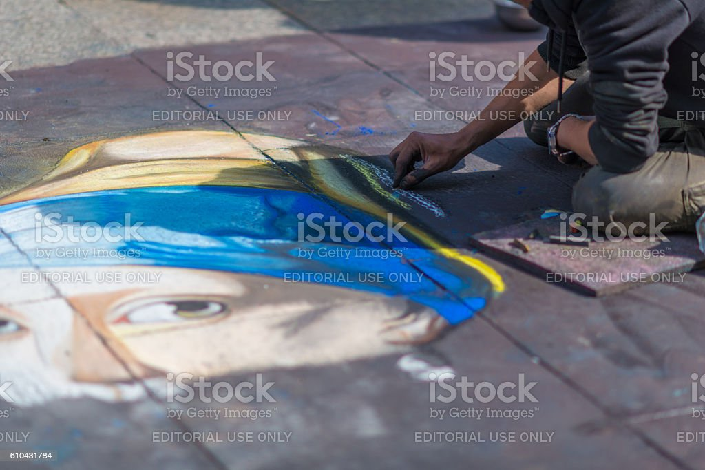 Street painter with artwork on bottom in Cologne Germany stock photo