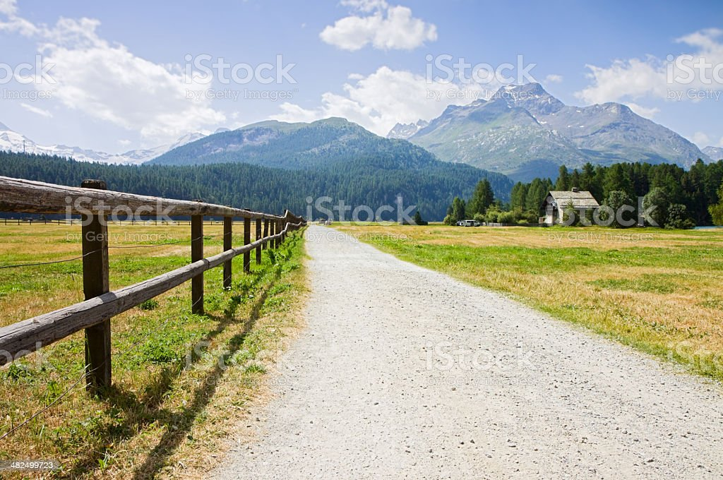 Street path in Engadine valley stock photo