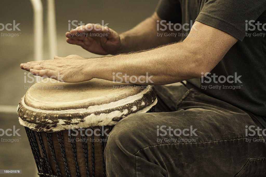 street percussionist playing african drum stock photo
