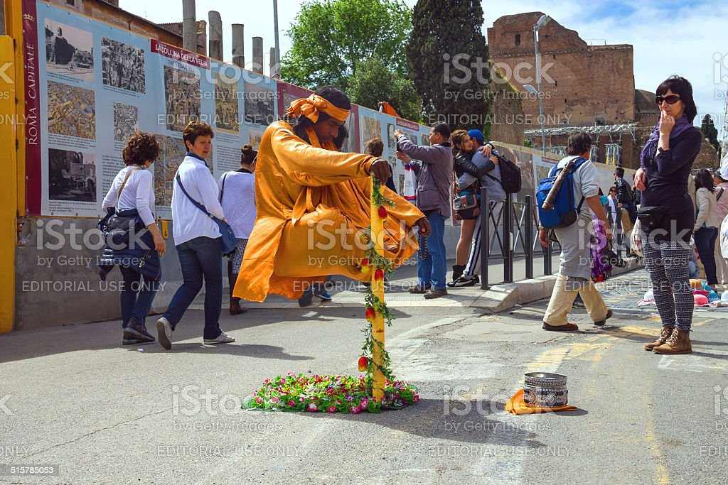 Street performer  demonstrates  trick of levitation in Rome, Italy stock photo