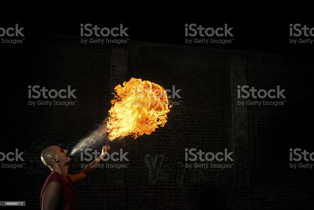 Street Performer Fire Breather Blowing on Torch royalty-free stock photo