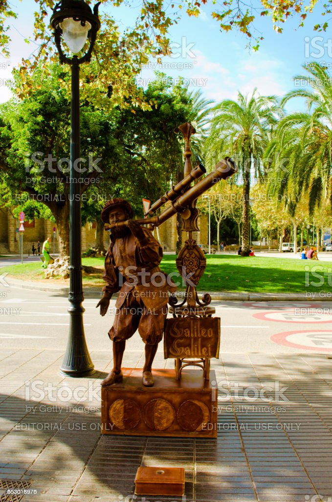 BARCELONA, SPAIN - OCTOBER 24: Street Performer imitating a monument to Columbus., famous La Rambla street, Barcelona, Catalunia, Spain on October 24, 2013. stock photo