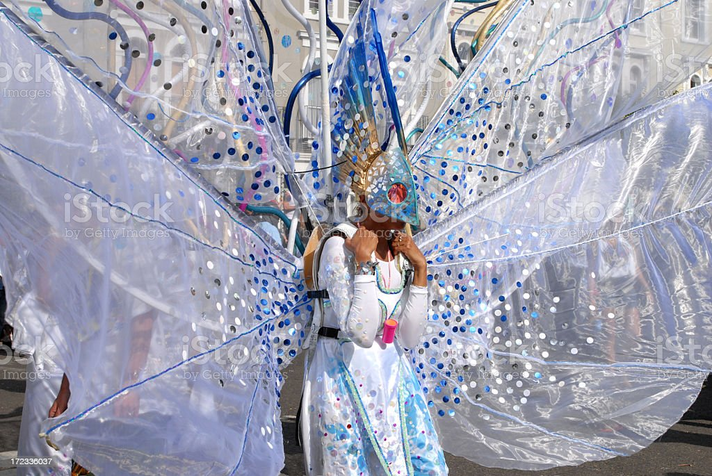 A street performer in a butterfly costume with big wings stock photo