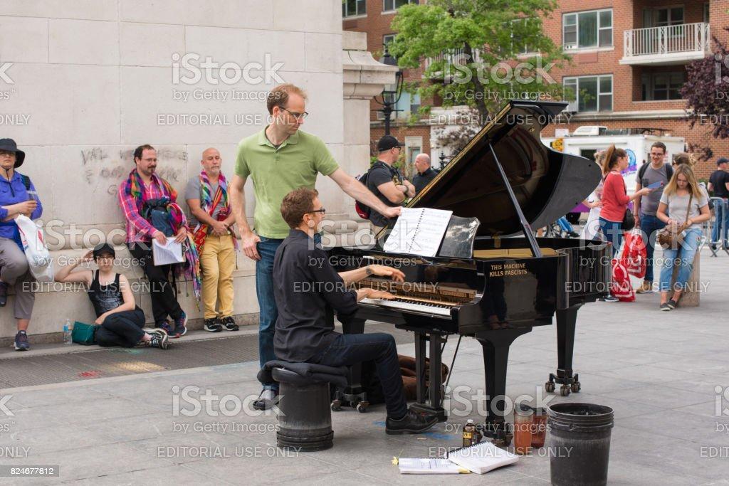 Street performer in Washington Square Park stock photo