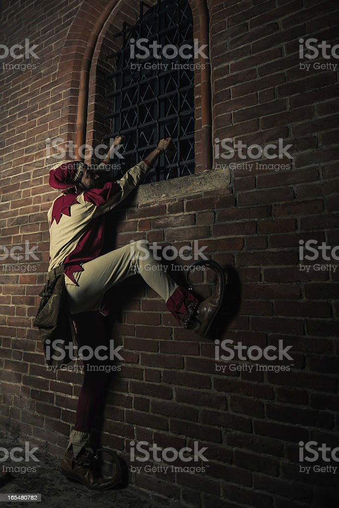 Street Performer Jester Climb Wall royalty-free stock photo