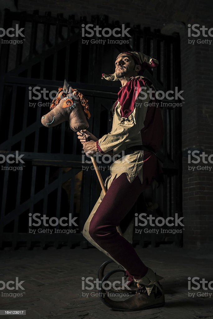 Street Performer Jester with Horse Puppet stock photo
