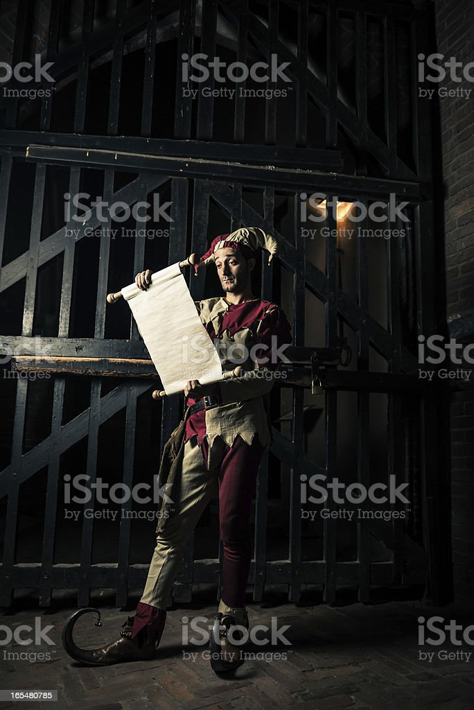 Street Performer Jester with scroll royalty-free stock photo