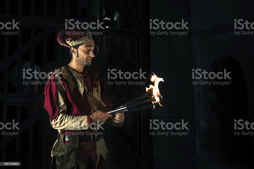 Street Performer Jester with Torch royalty-free stock photo