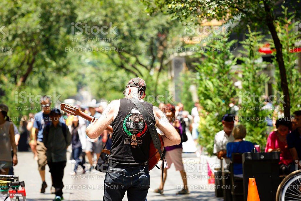 Street performer plays his guitar on Pitt Street Sydney Australia stock photo