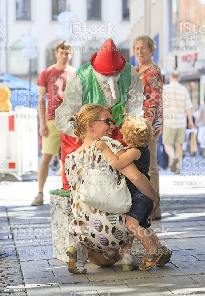 "Street performer ""Pinocchio"" greeting young spectator royalty-free stock photo"
