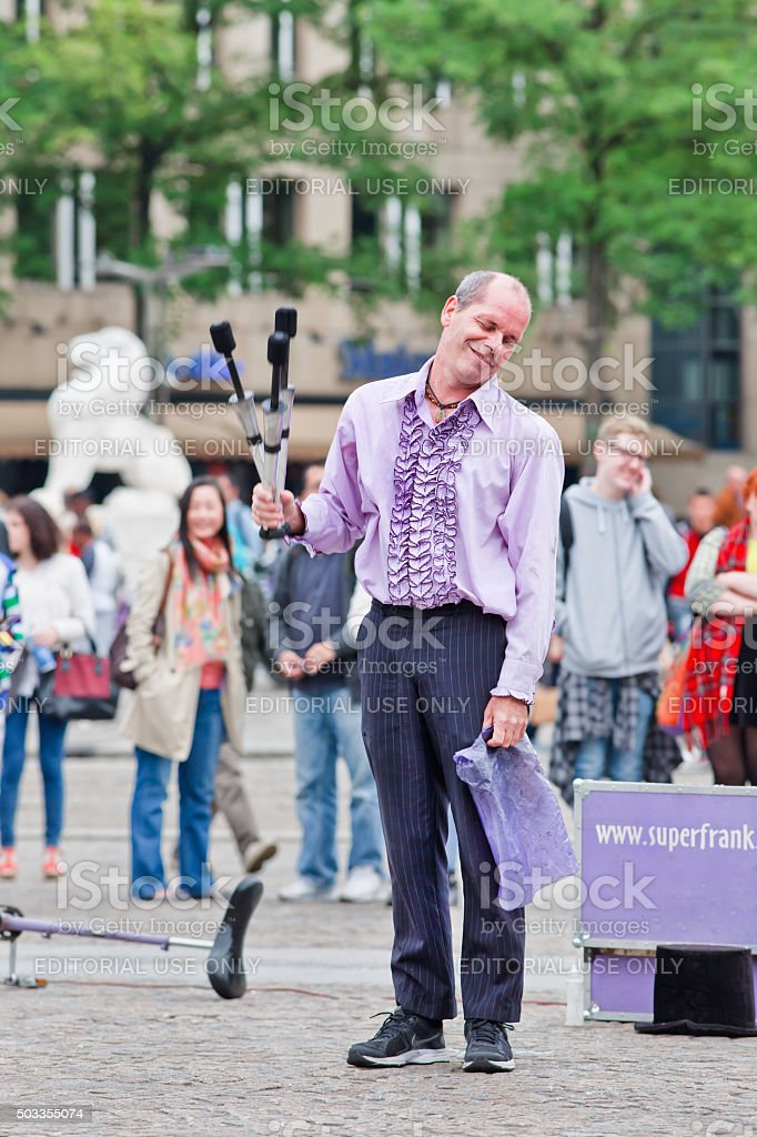 Street performer Superfrank gives a show on Amsterdam Dam Square stock photo