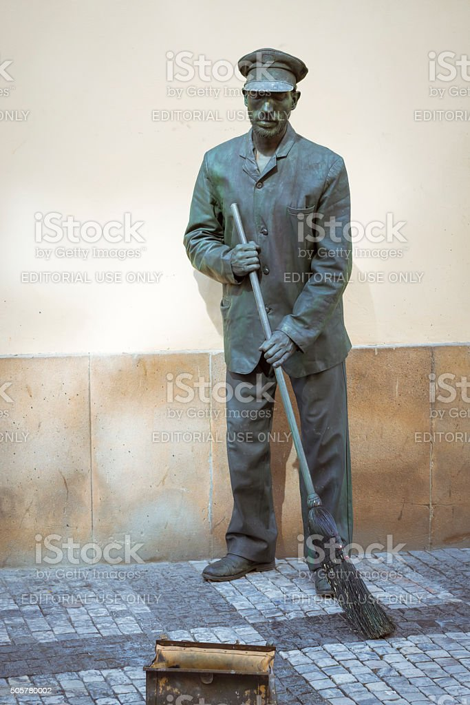 Street performer-meme in the guise of a janitor stock photo