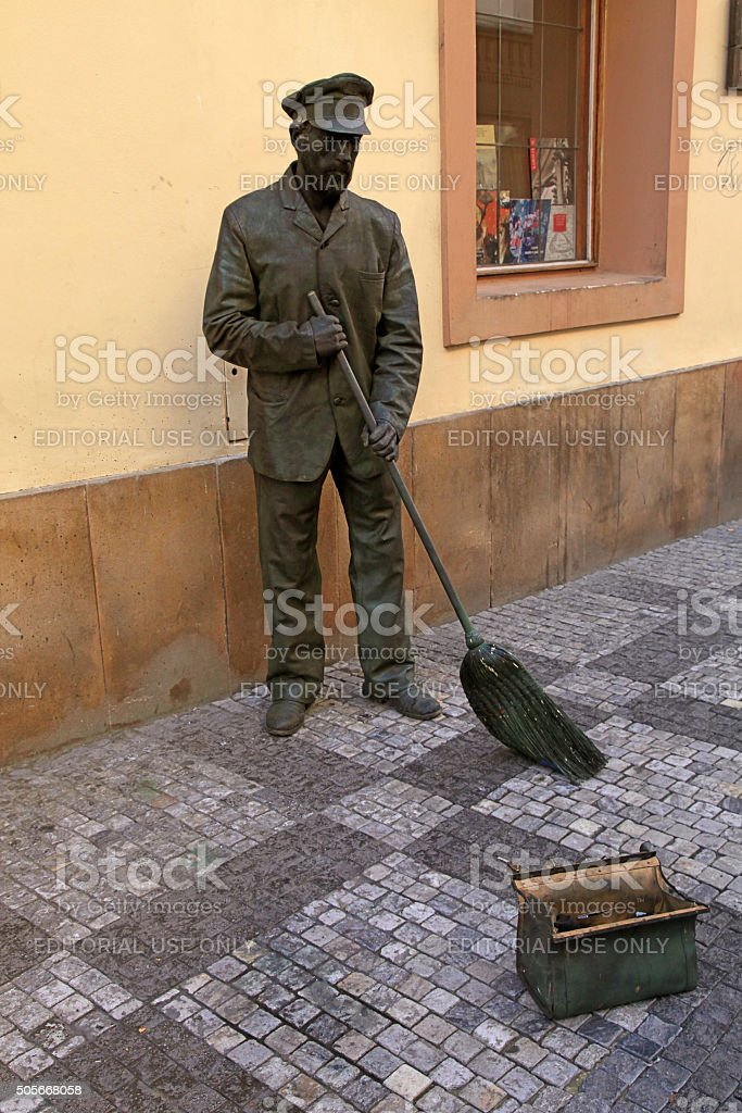 Street performer-mime in guise of a janitor, Old Town, Prague stock photo