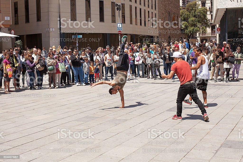 Barcelona, Spain-May25, 2013. Young men perform acrobatic dance...