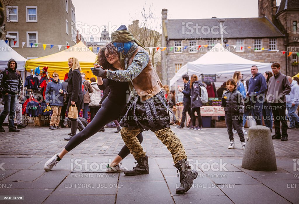 Street Performers Dance in Edinburgh's Grassmarket stock photo