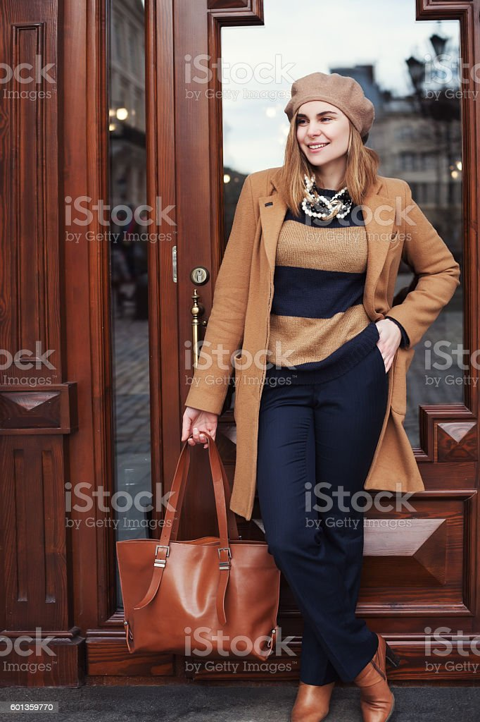 Street photo of young beautiful happy smiling lady wearing stylish stock photo