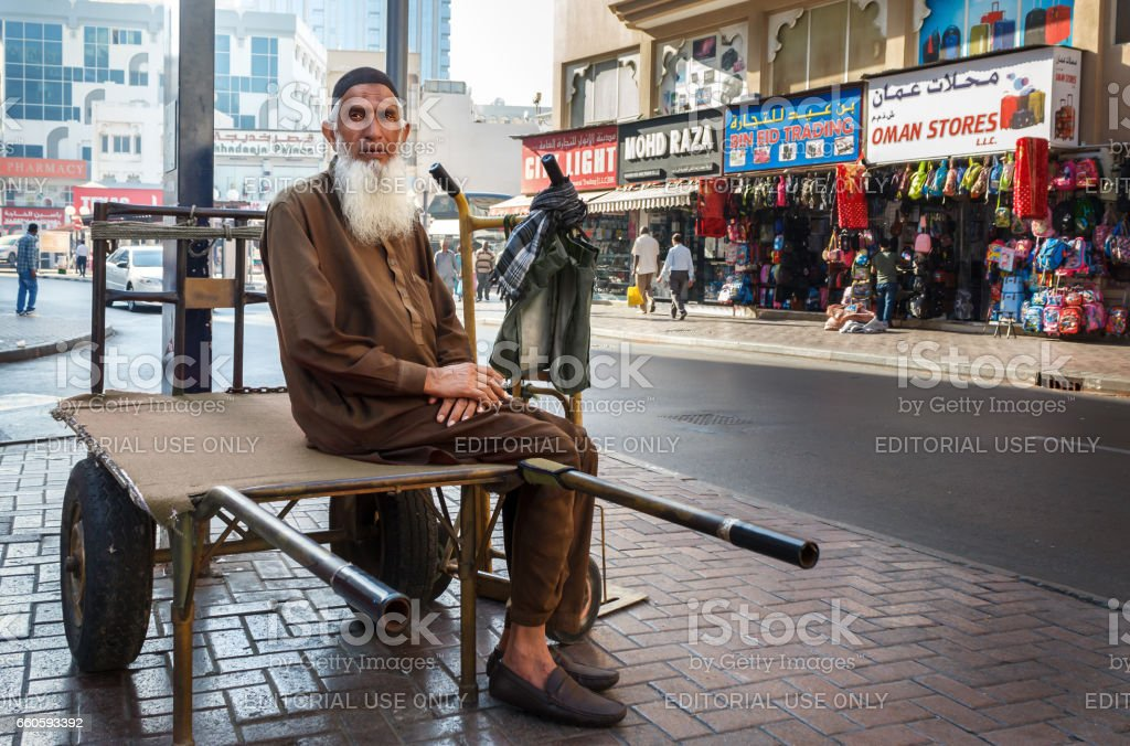 Street porter with a cart waiting for work. portrait stock photo