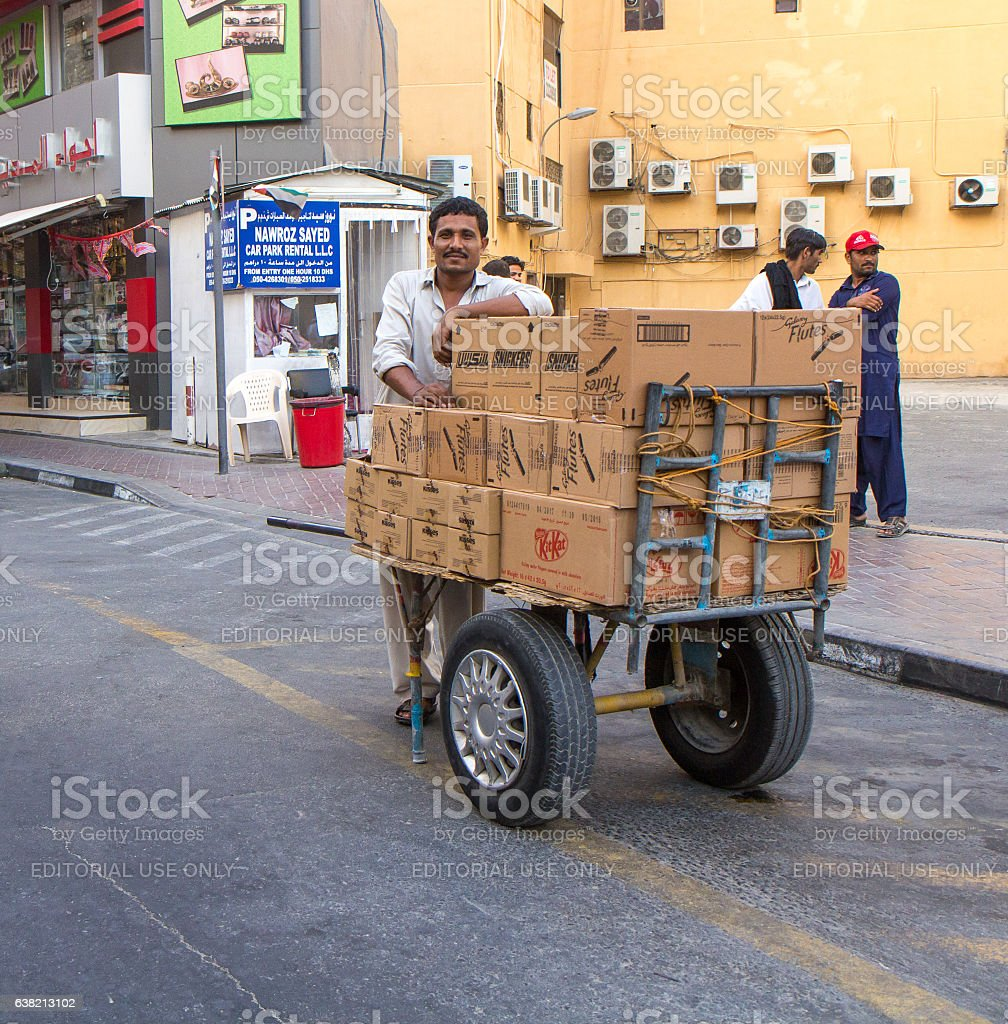 Street portrait of a resident in Dubai Al Naif neighborhood. stock photo