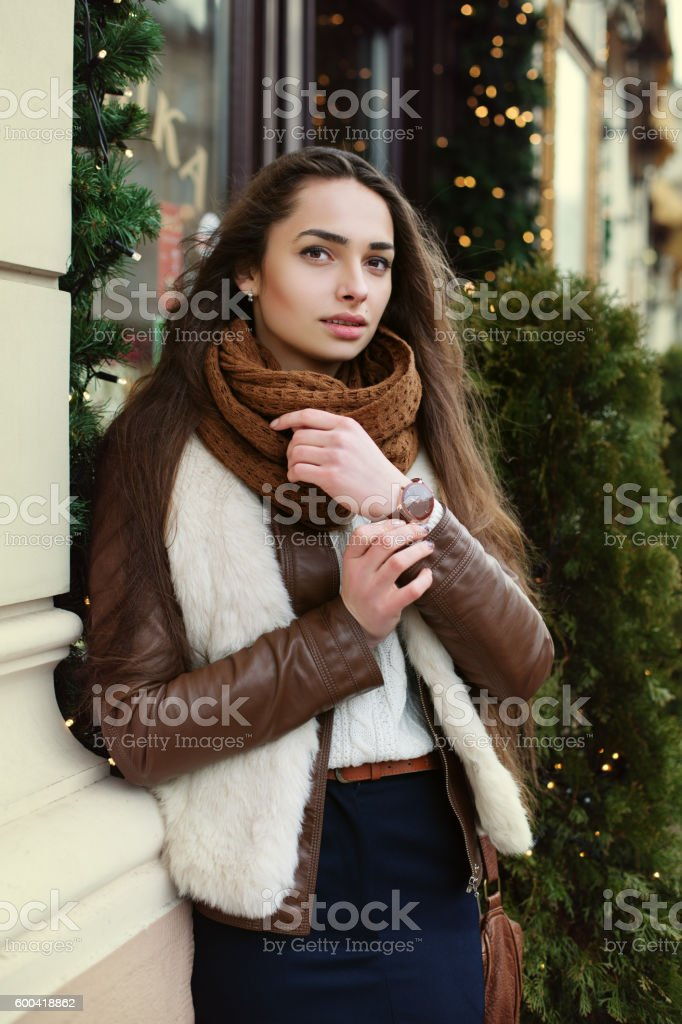 Street portrait of young beautiful fashionable lady wearing stylish clothes stock photo