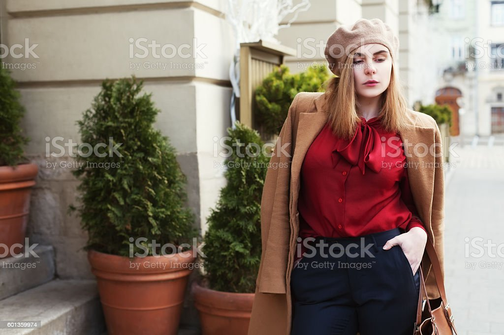 Street portrait of young beautiful woman wearing stylish classic clothes stock photo