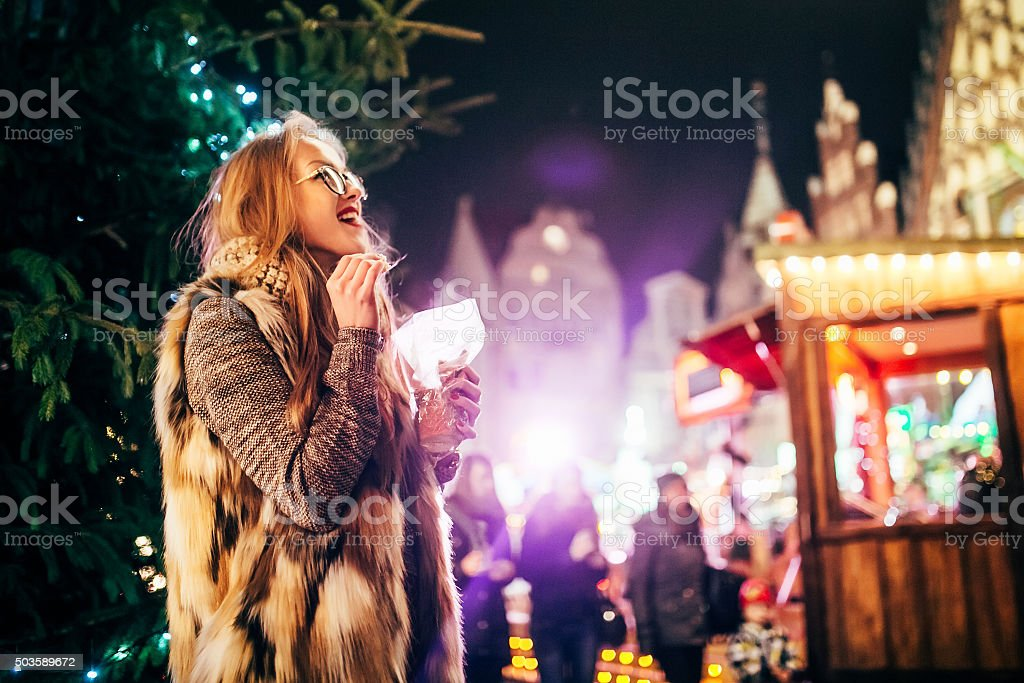 Street portrait  young woman on the festive Christmas market stock photo