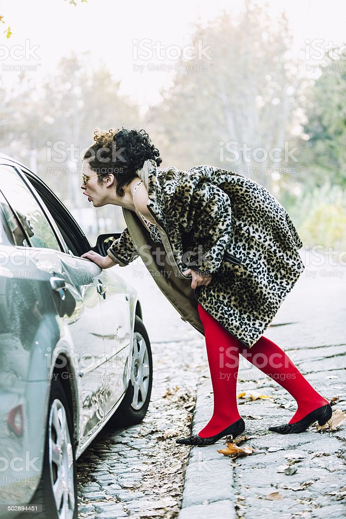 Street prostitute approaching car stock photo