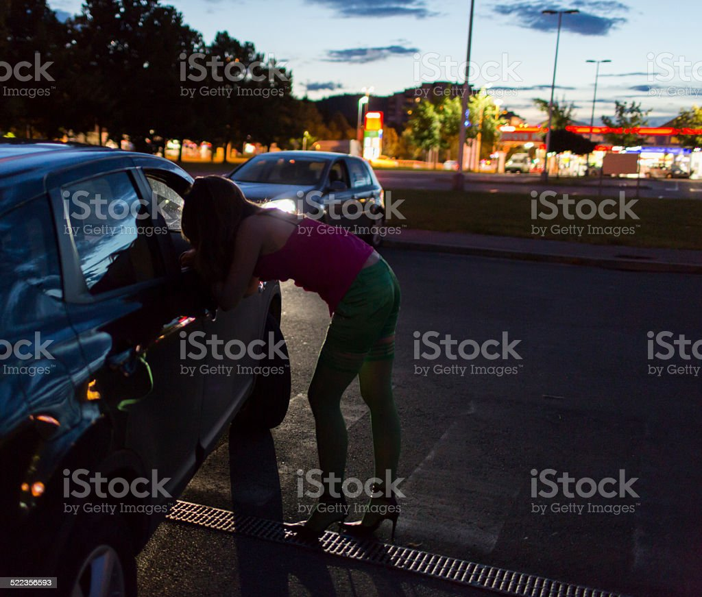 Street prostitute of Eastern Europe talking with possible client stock photo