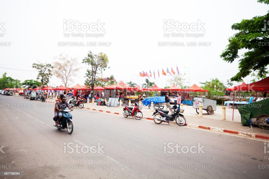 Street Quai Fa Ngum and night market in Vientiane stock photo