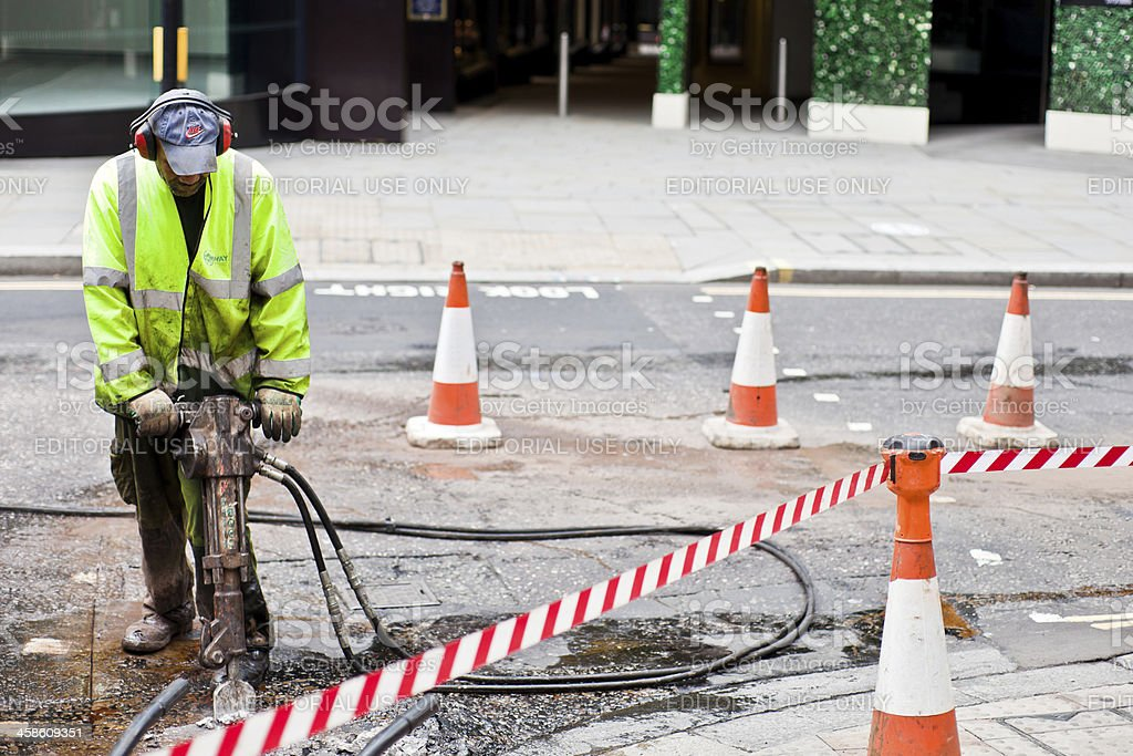 Street Repair Worker with jackhammer in London stock photo
