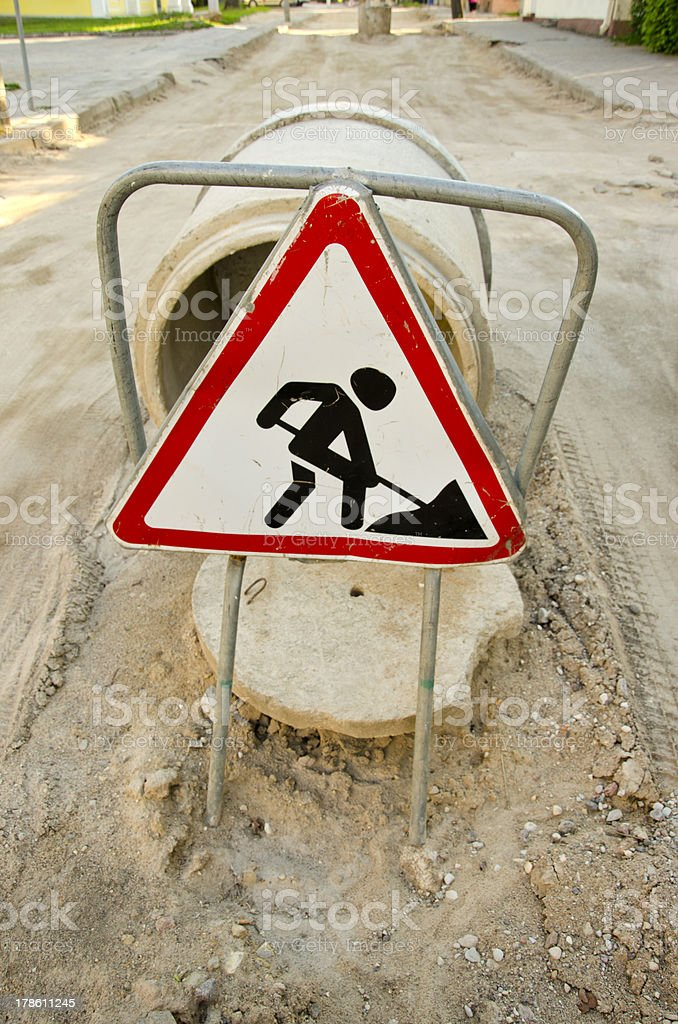 street repair works and road sign stock photo