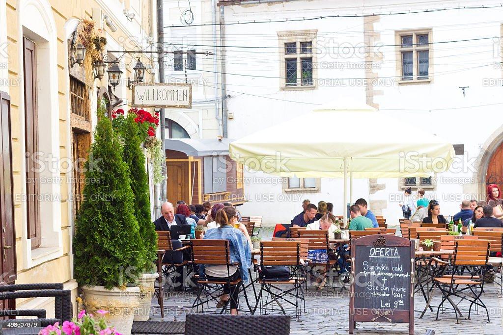 Street restaurant with umbrellas in Cluj-Napoca stock photo