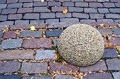 street road brick background and granite ball