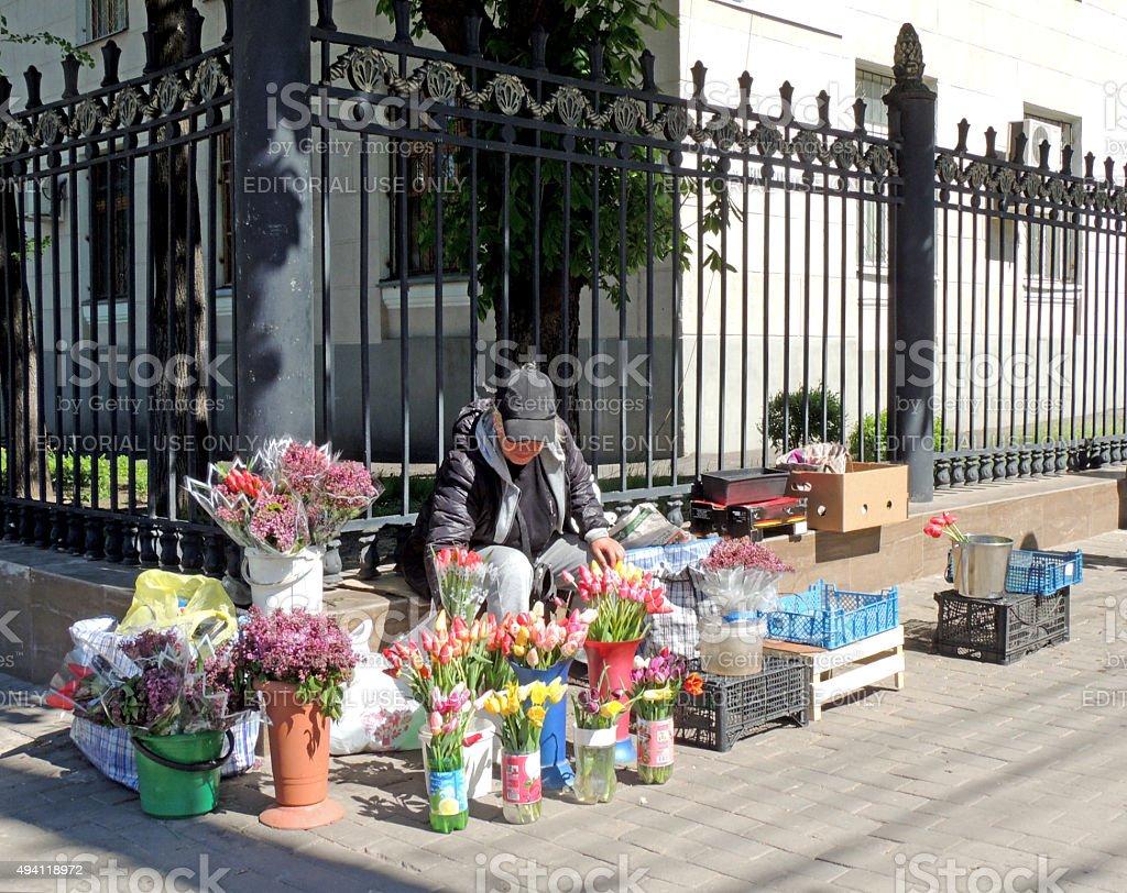 Street saleswoman of flowers stock photo