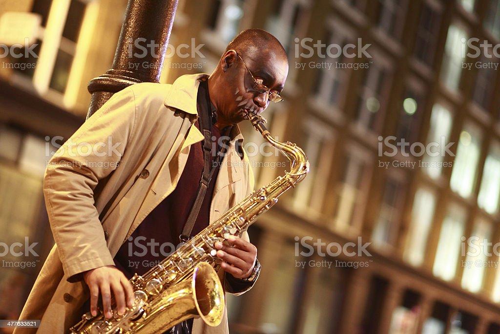 Street sax player stock photo