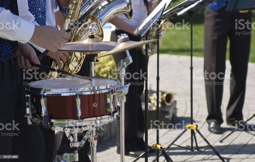 Street saxophone quintet playing on city holiday royalty-free stock photo