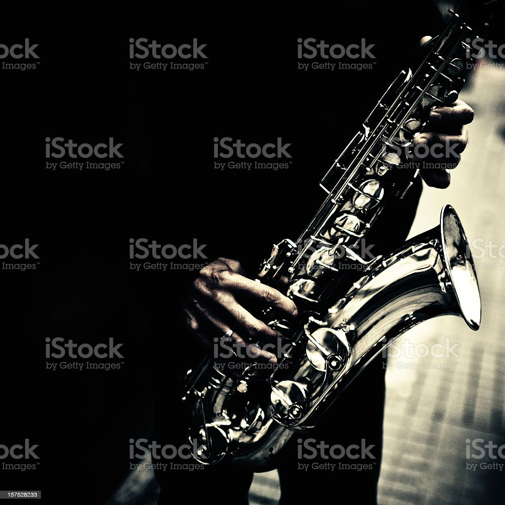 street saxophonist detail stock photo