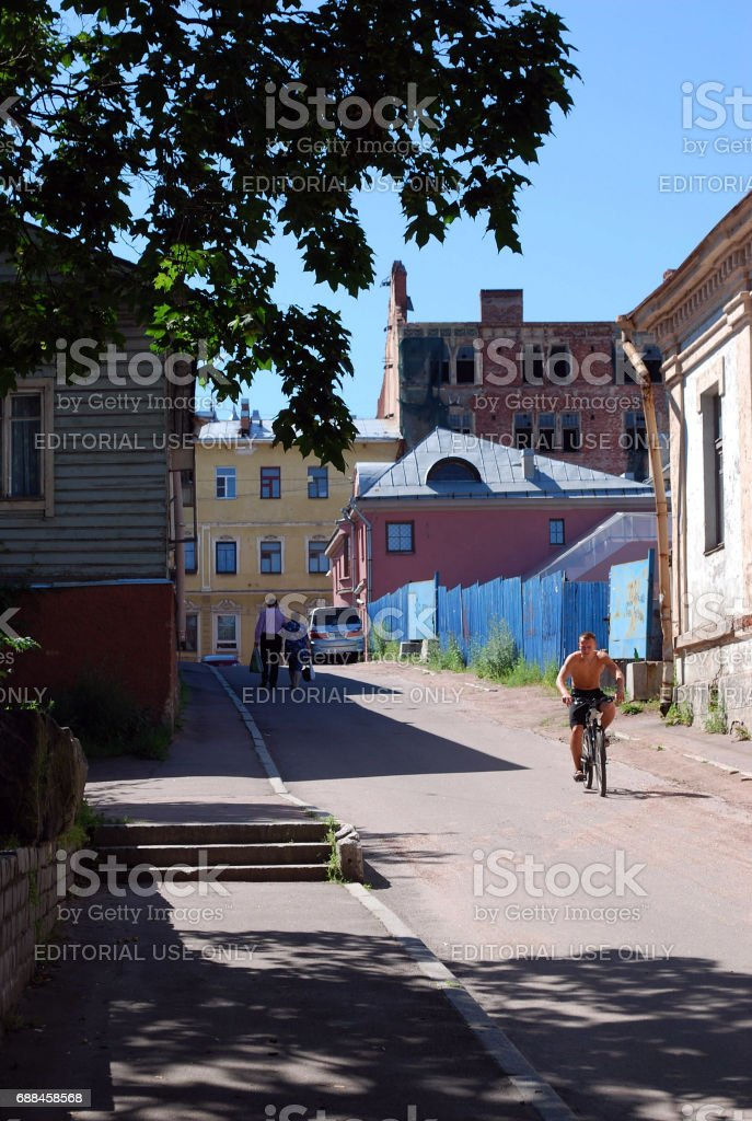 Street scene at noon with natives in one of the old fashioned Vyborg neighbourhoods stock photo