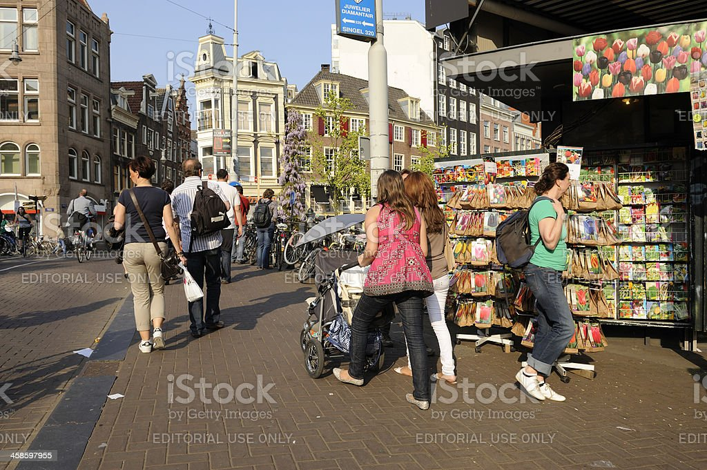 Street scene in Amsterdam with shop selling flower seeds royalty-free stock photo